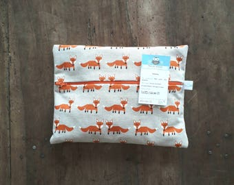 Pouch/clutch cotton with orange foxes, lined with beige polka dot fabric