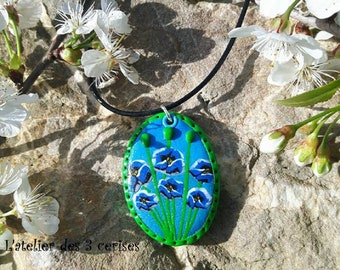 Oval necklace with blue poppies made of polymer clay