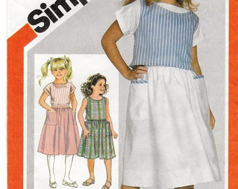 """A Sleeveless Top, Short Sleeve Blouse, and Gathered Skirt Pattern for Girls: Uncut - Sizes 10-12-14, Breast 28-1/2""""-32"""" • Simplicity 6304"""