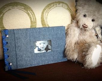 Handmade, self mount, ribbon bound photo album.