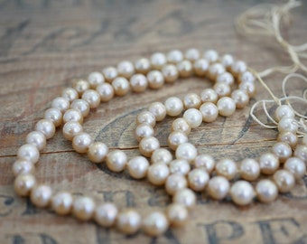 Vintage Glass Pearl Strand 21 inches long Two tone Cream Luster Color Pearls 6mm mix Knotted Pearls with Long Silk Cords Ends (1 Strand) DA4