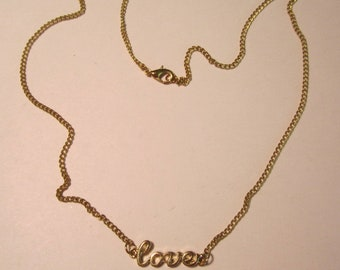 Goldtone Necklace with the word 'love'.   (#777)