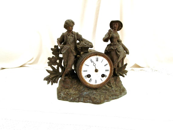 Antique French Cast Metal Mantle Clock With Flower Seller Children Figurines and White Enamel Clock Face, Retro Time Piece from France
