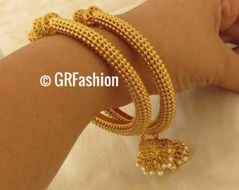 Beautiful high quality gold plated bangle pair