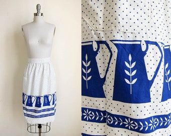 1960s vintage white royal blue pitcher pattern polka dot self tie waist pocket apron