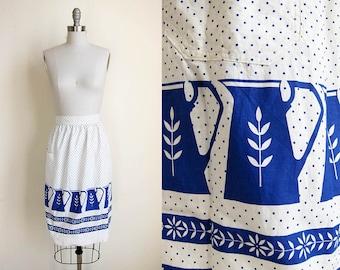 1960s vintage white royal blue pitcher pattern polka dot self tie waist pocket apron