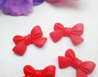 Red Bow appliques in resin (x 4)