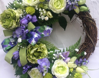 Grapevine wreath with lavender, green and white flowers