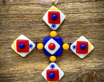 Swedish Cross glass ornament in white, red, blue and yellow hues
