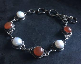 Sterling, carnelian and pearl link bracelet, adjustable toggle closure