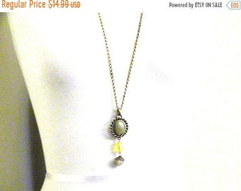 30% Off Sale Vintage 33 inch gold tone Necklace with Green and Yellow Cabochon and Beads