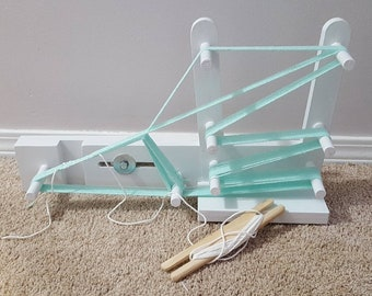 Inkle loom 2 yard hand made very sturdy slide adjustment. Weaves up to 4 inch belts or straps. Shuttle not included.