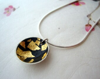 Oxidized silver bowl pendant with gold leaf on silver chain