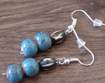 Dangle earring natural seed and African bead.