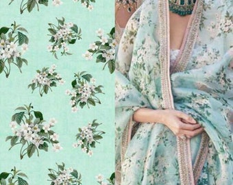 Summer's delightful with this printed organza saree from sabhyasaachi's vision!