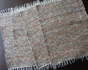 Almost Paisley with Browns, creams and hints of light blue handwoven place mats, place setting, table mats