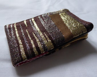 Oyster card holder with a Brocade, metallic thread fabric. Also great for housing a bus pass!