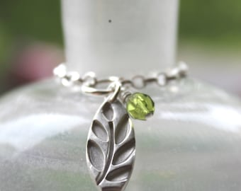 Contemporary silver leaf necklace with olive green glass bead, green leaf silver pendant, handmade silver pendant, minimalist leaf pendant