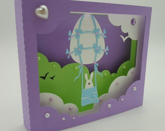 3d cardboard Box in balloon and bunny