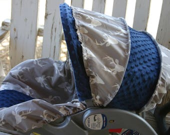 gray with white buck marks and navy blue minky infant car seat cover and hood cover