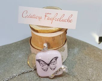 Pink fused glass pendant with butterfly