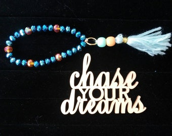 Dreamer - whimsical beaded stretch bracelet with hanging wood bead and yarn tassel