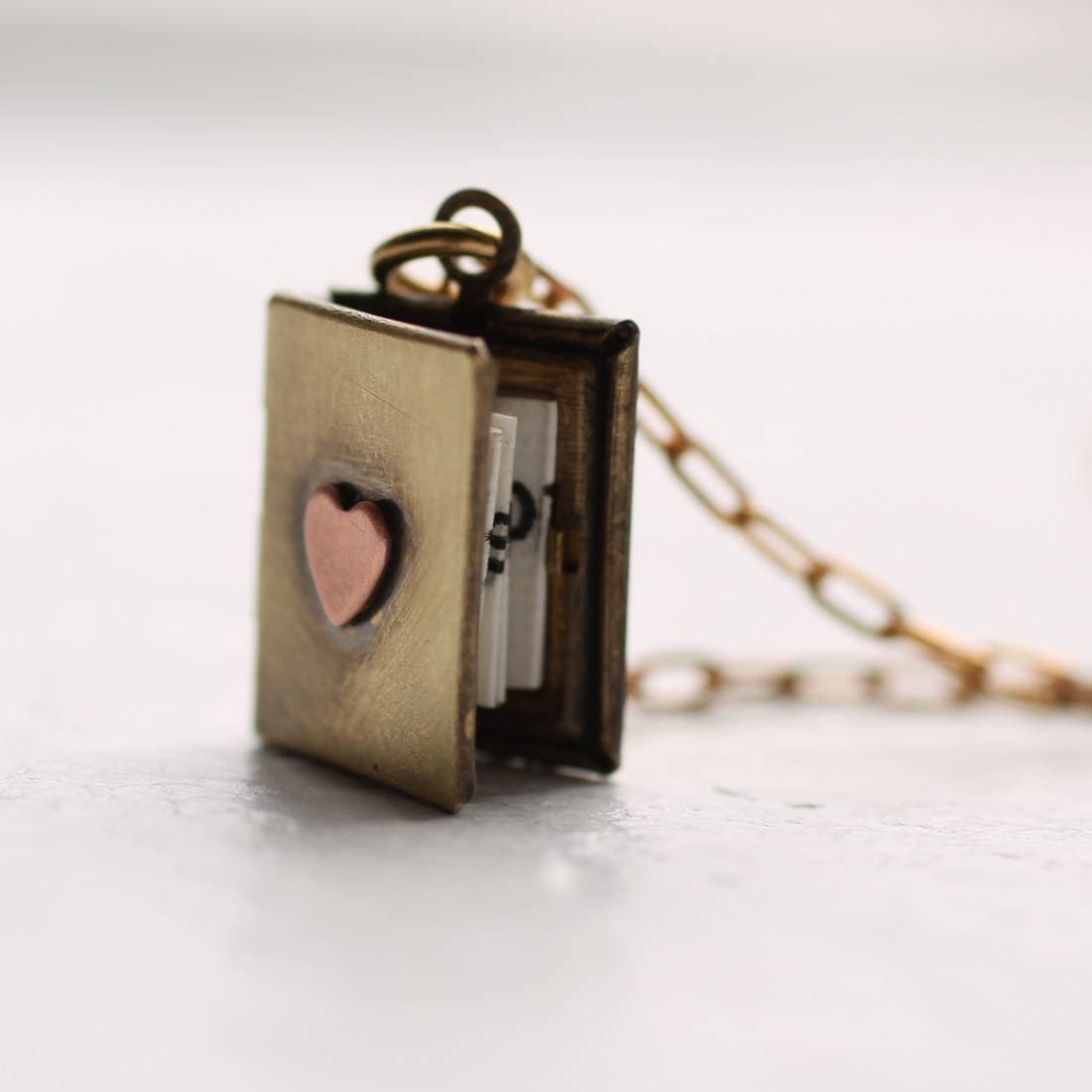 lockets secret illusionist youtube heart locket watch