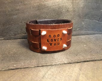 GOD LOVES YOU on woven leather band
