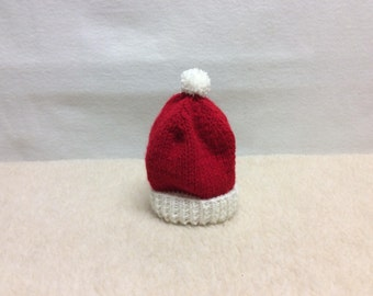 Knit red and white baby hat