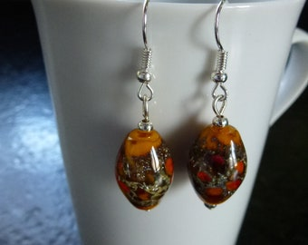 earrings with oval glass beads Lampwork yellow saffron/orange/red/glitter mounted on silver plated hooks