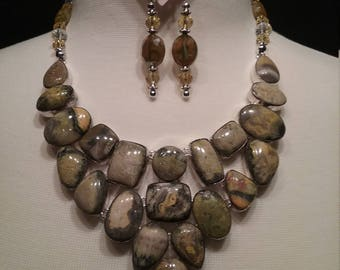 Earthy greens, Browns, yellows and orange makes up this Eclipse Stone from Africa Bibb