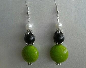 Green and black dangle earrings
