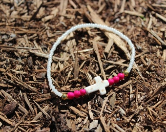 White cross stretch bracelet with bright pink accent