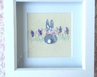 Dilly Rabbit in the lavender framed  free motion machine embroidery picure.