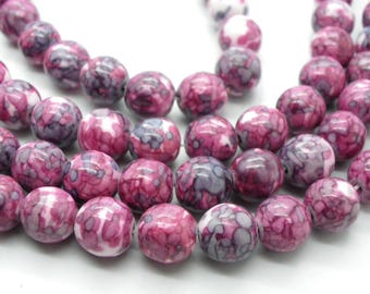 20 jade beads 10 mm original drawings has pink, blue, green, white 1 strand