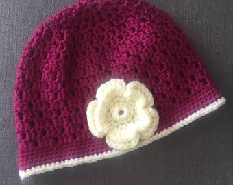 Crocheted raspberry sorbet and lemon frosting women's cloche.