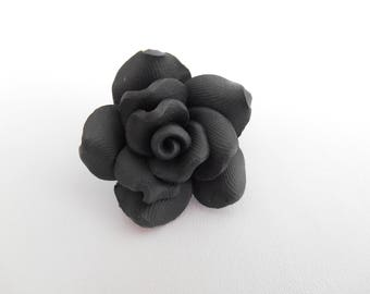 A large black polymer clay flower bead.