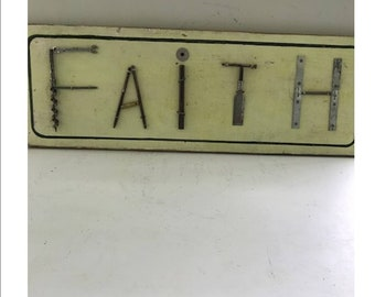 Faith sign - Junk Art using items to simulate the letters HOPE.