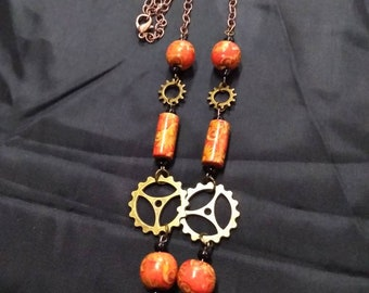 Eastern steampunk necklace with multi sized gears