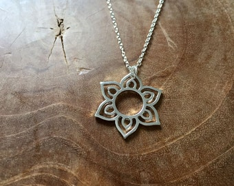 Sun - necklace with an outline pendant of the sun or a flower. Silvertone, cute, indian, delicate, minimal, boho, gypsy, hippie, bohemian