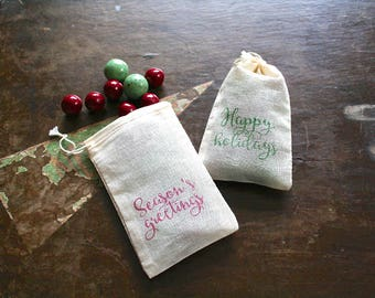 Christmas gift bags, set of 10. Happy Holidays and Season's Greetings in red and green.  Great gift card holder. Hand stamped muslin bags.