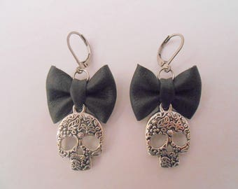 Skulls with black leather bow earrings