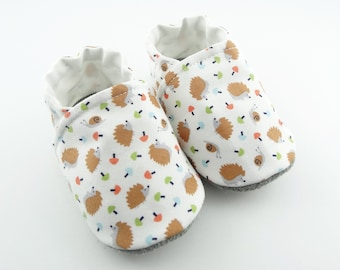 Sole leather baby shoes and white cotton top with hedgehogs