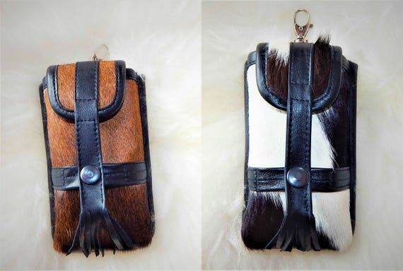 Phone leather case. Adjustable size. Different colors. Genuine leather. Very soft. Prime quality