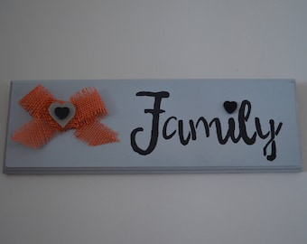 "Handcrafted wooden sign that says ""Family"""