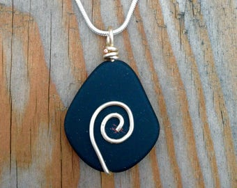Wire wrapped smooth black stone