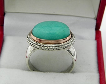 AAA Amazonite Cabochon   14x10mm  5.75 Carats   in 18K Rose gold and Sterling silver ring.  1558