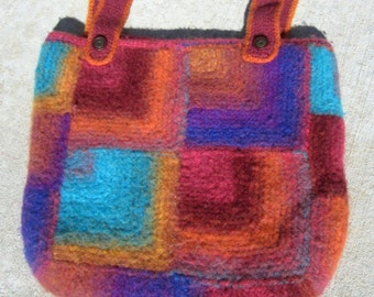 Women's felted bag, felted purse, large purse, felted tote bag, large shoulder bag made with brightly colored Noro wool yarn. Mitered stitch