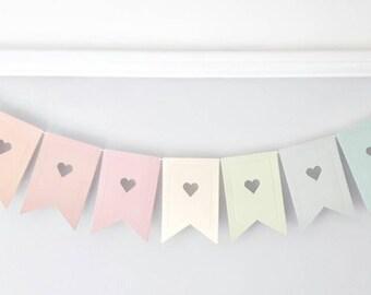 Pastel rainbow bunting garland banner baby room nursery decor children's decoration heart detail.
