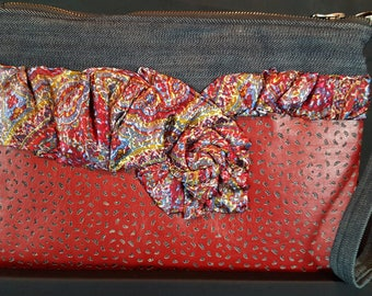 Custom made denim clutch accented with a necktie. One of a kind